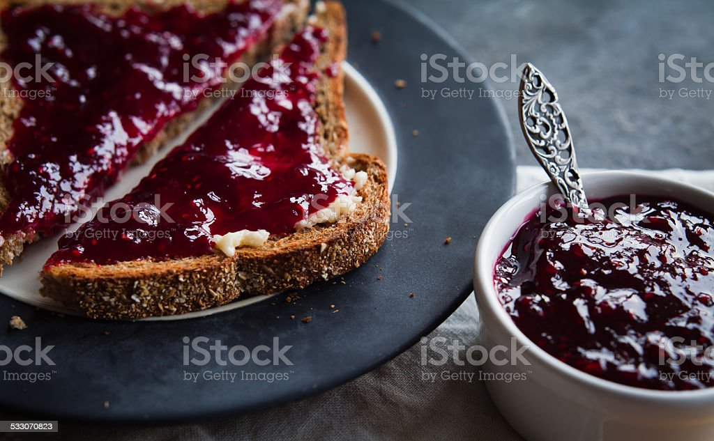 Bramble jam on toast bread stock photo