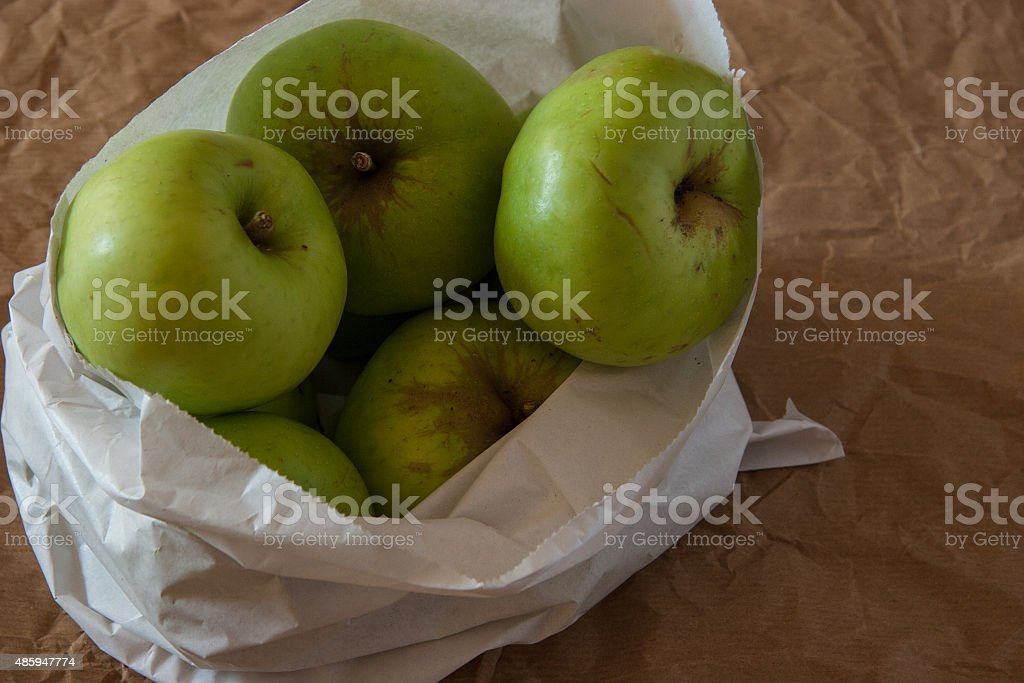 Bramley Cooking Apples in a paper bag stock photo