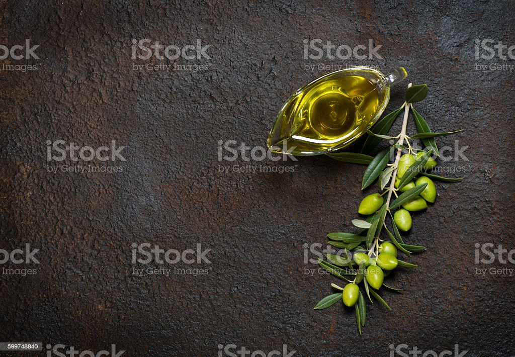 Branch with olives and olive oil, above view. stock photo