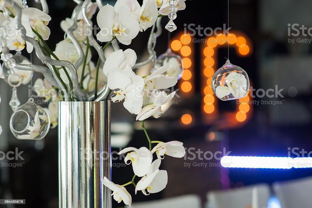 Branches of the orchid in a silver vase stock photo