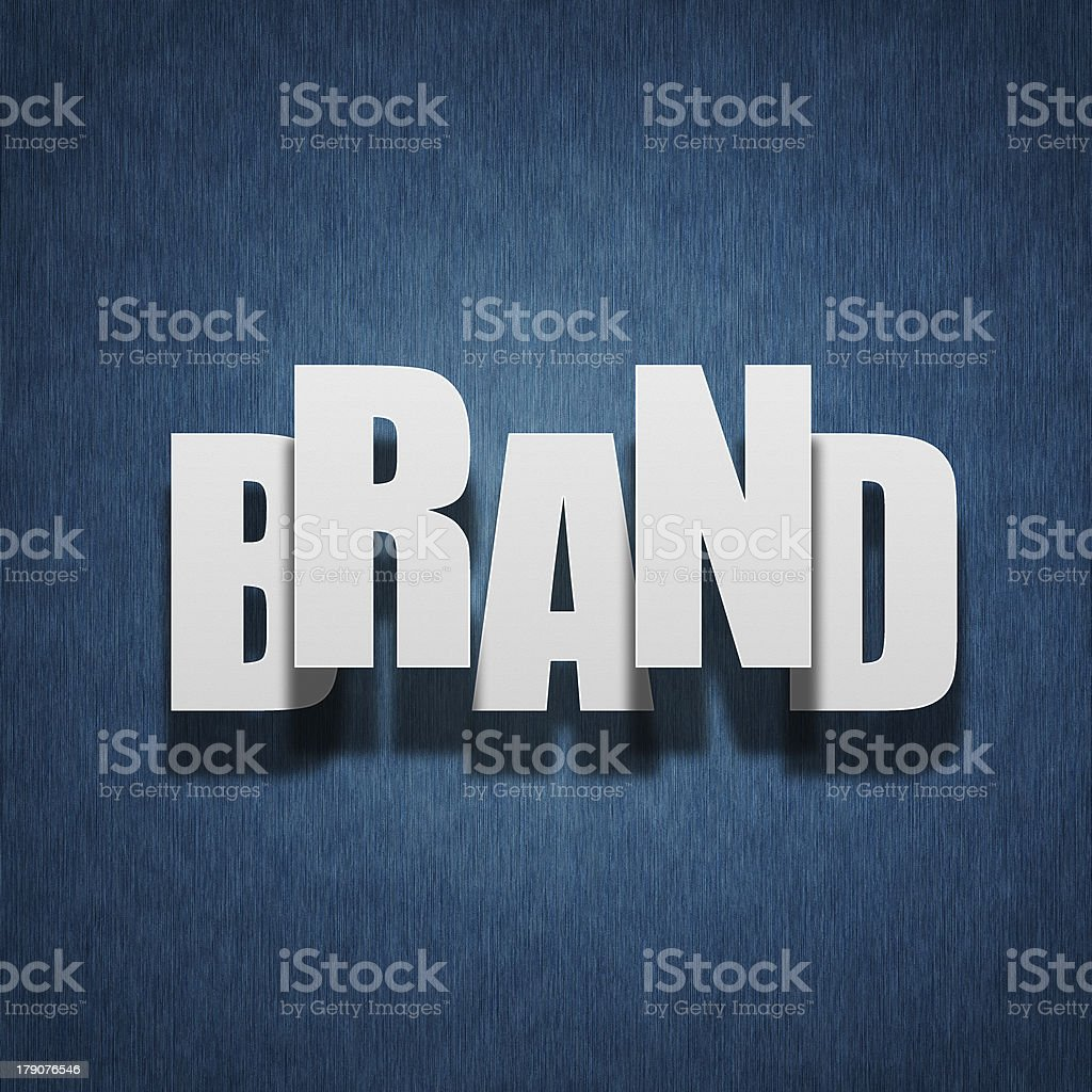 Brand concept - paper letters on textile royalty-free stock photo