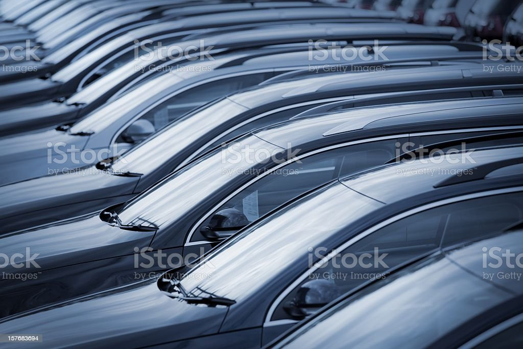 Brand new cars in a row at dealership stock photo