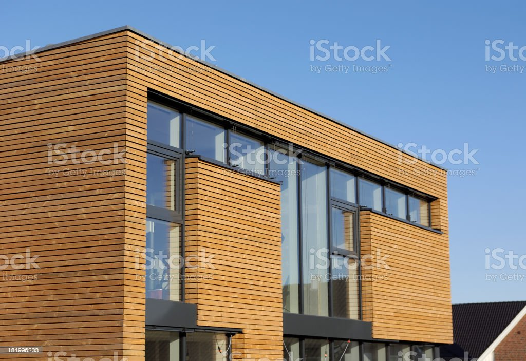 Brand new cubistic house covered with timber accents stock photo