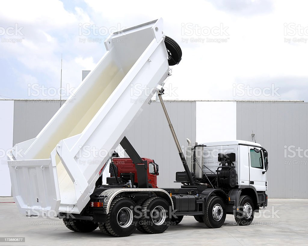 A brand new dump truck lifted up for view stock photo