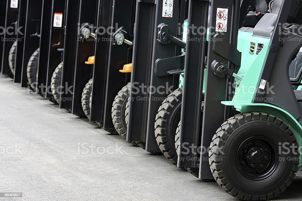 Brand new forklifts are lined in a row stock photo