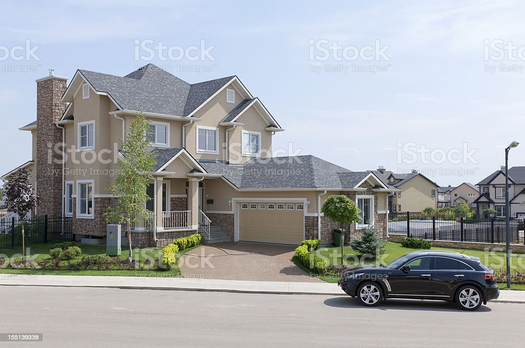 Brand new suburban house in sunny summer afternoon. stock photo