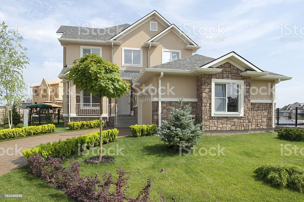 Brand new suburban house in sunny summer afternoon royalty-free stock photo