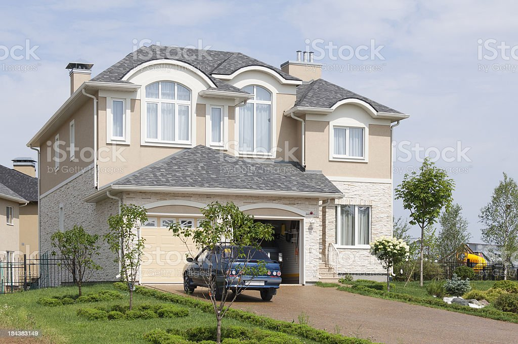 Brand new suburban house in sunny summer afternoon. royalty-free stock photo