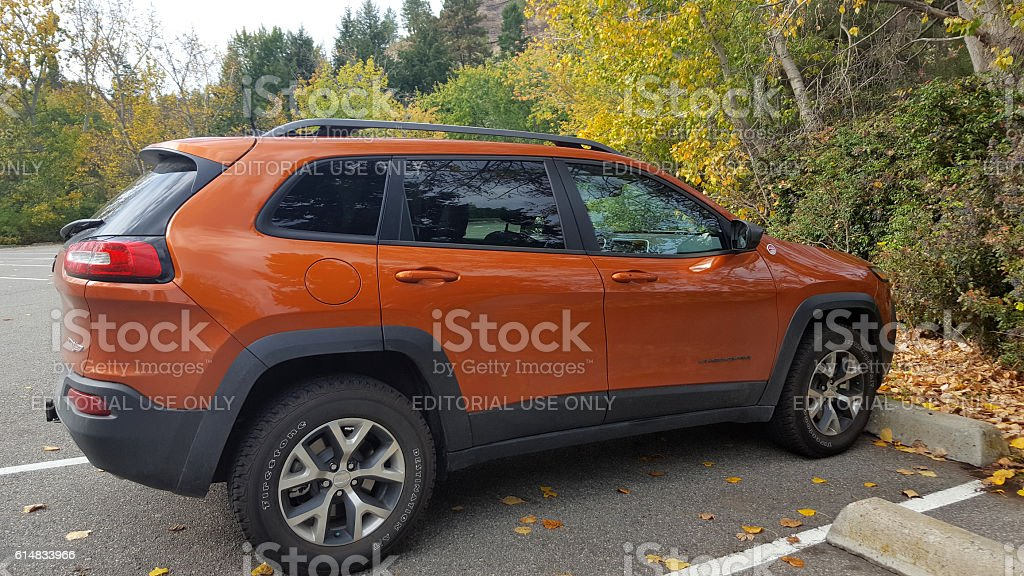 Brand New SUV Parked In Fall Location stock photo