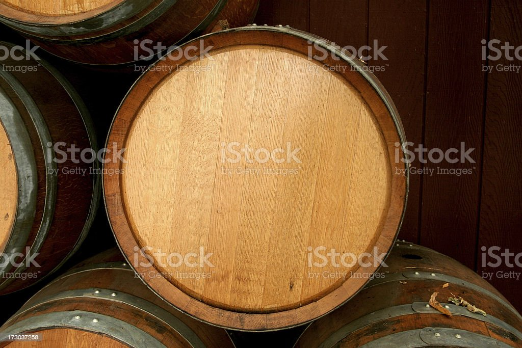 Brand new wine barrel sitting on top of other barrels royalty-free stock photo