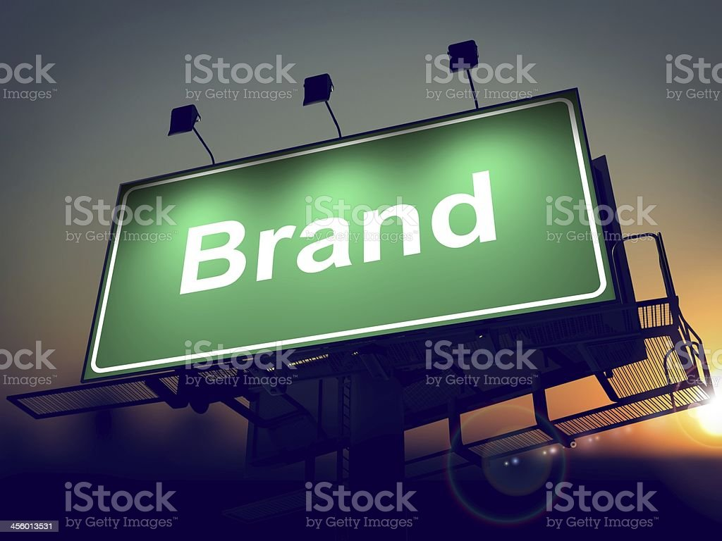 Brand on Green Billboard at Sunrise. stock photo
