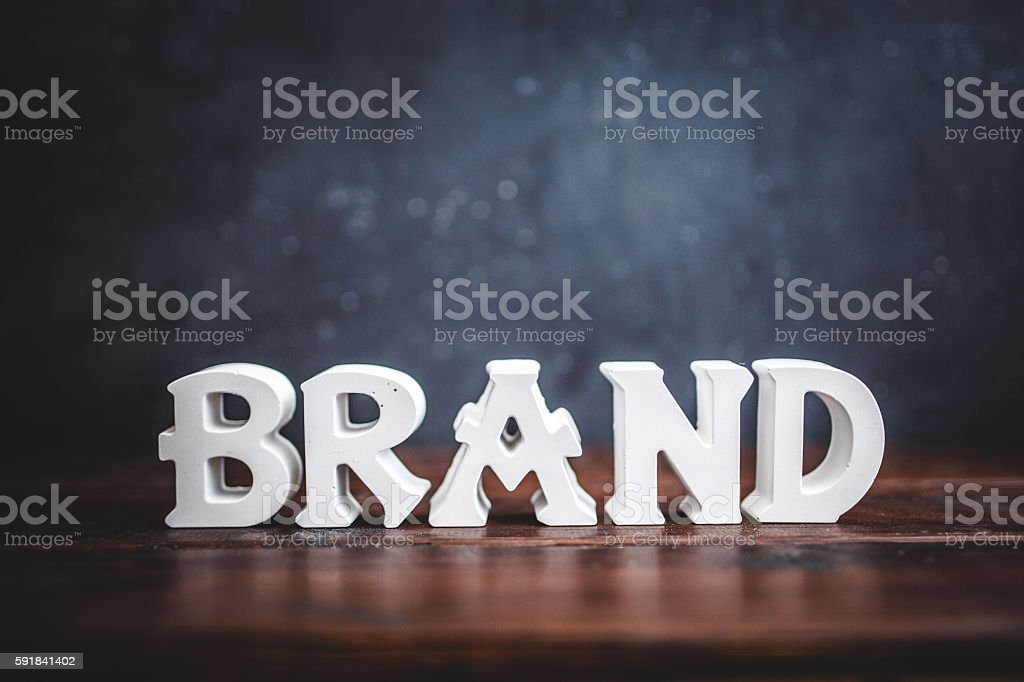 Brand - White color text on blackboard stock photo