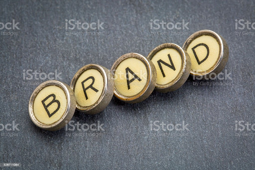brand word in  typewriter keys stock photo
