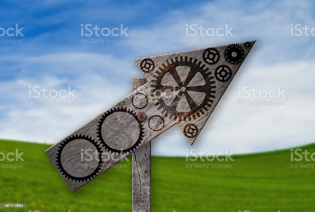 Branded Gear Symbols on an rustic arrow sign stock photo