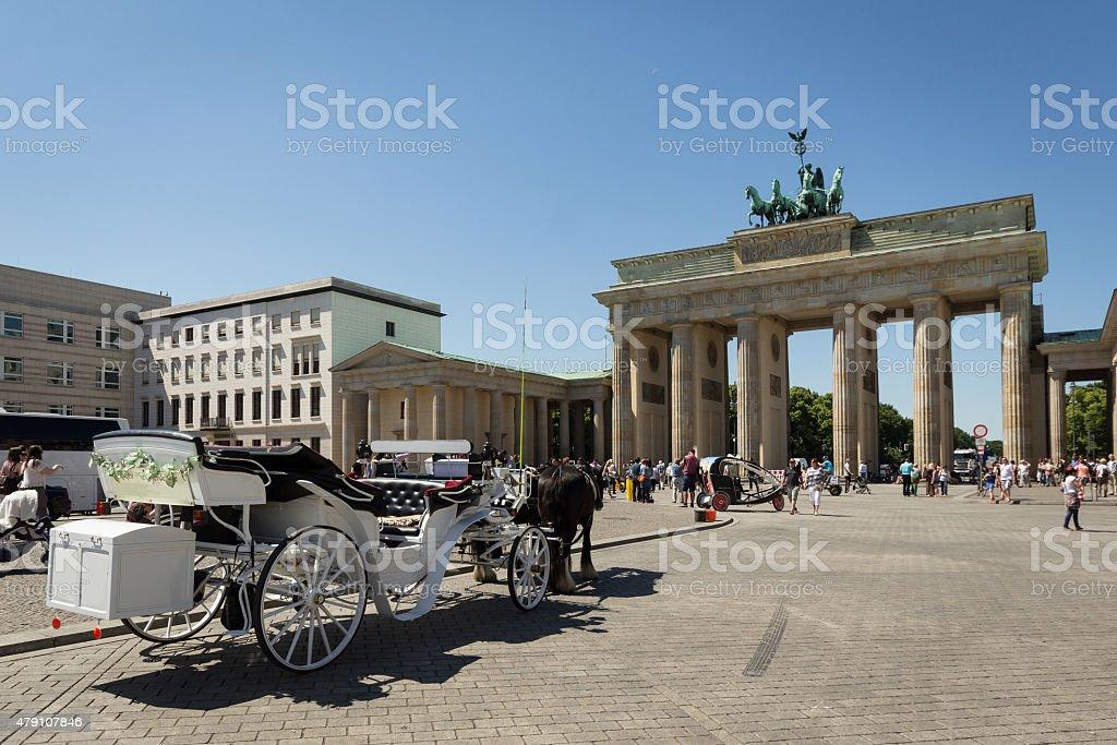 Brandenburg gate, berlin , germany - horse carriage stock photo