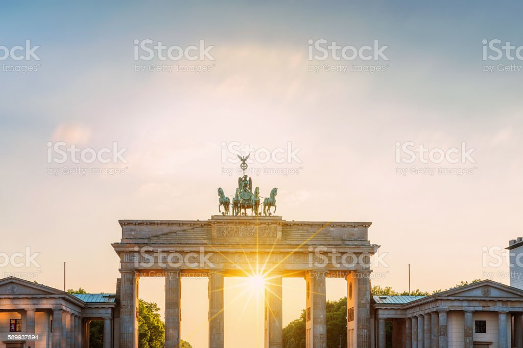 Brandenburg Gate with sun, Berlin, Germany stock photo
