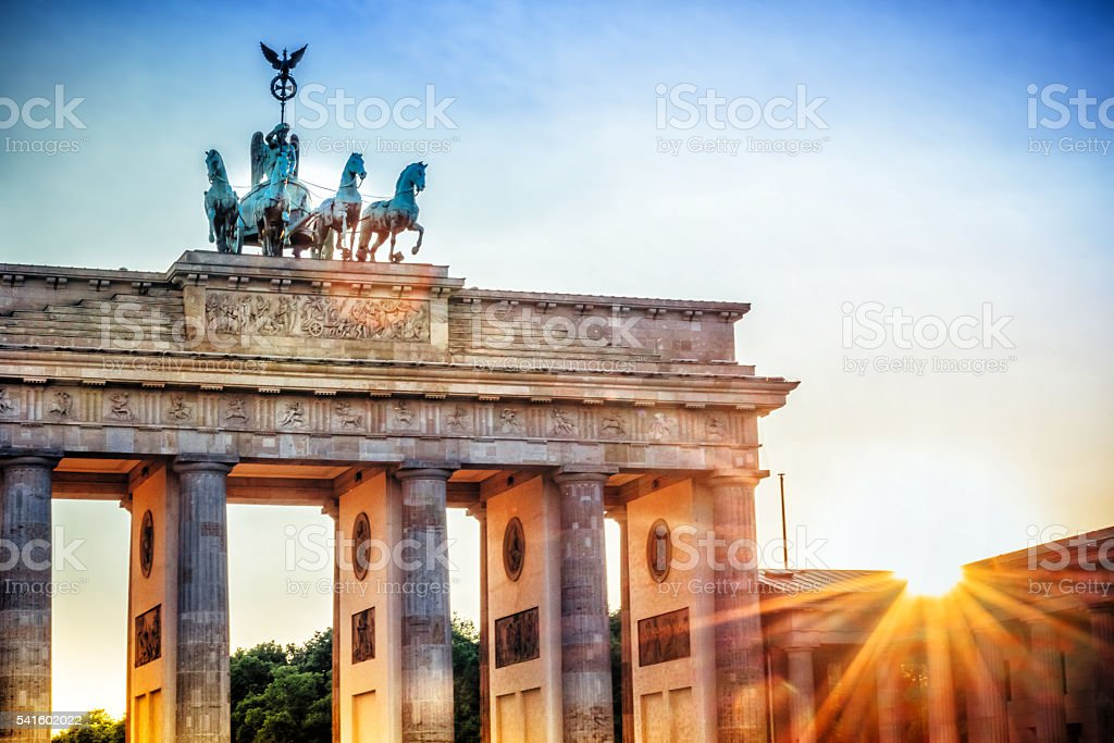 Brandenburger Tor with Quadriga in Berlin at sunset stock photo