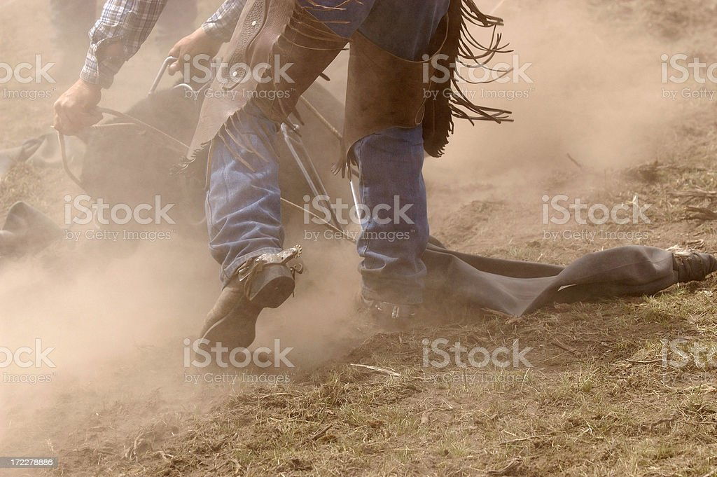 Branding, Boots,Chaps and Dust royalty-free stock photo