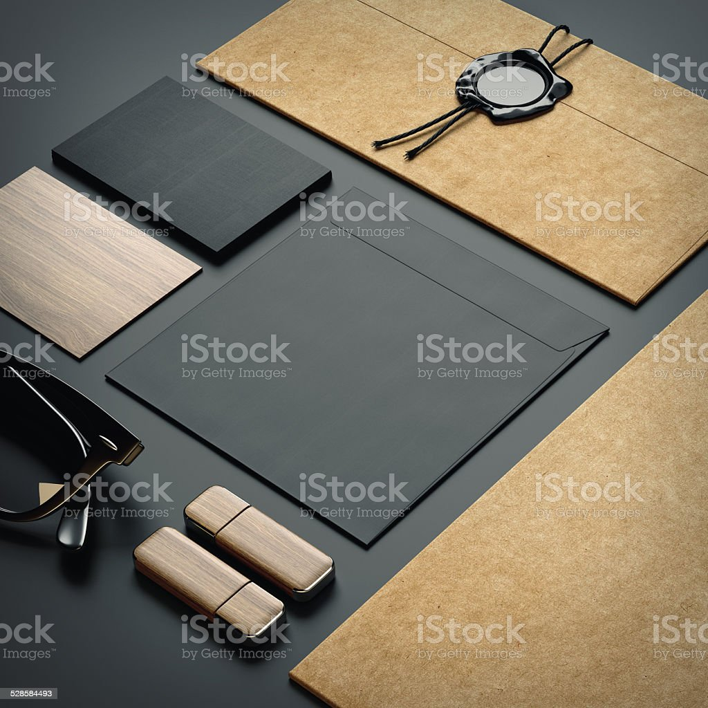 branding elements on black paper background stock photo