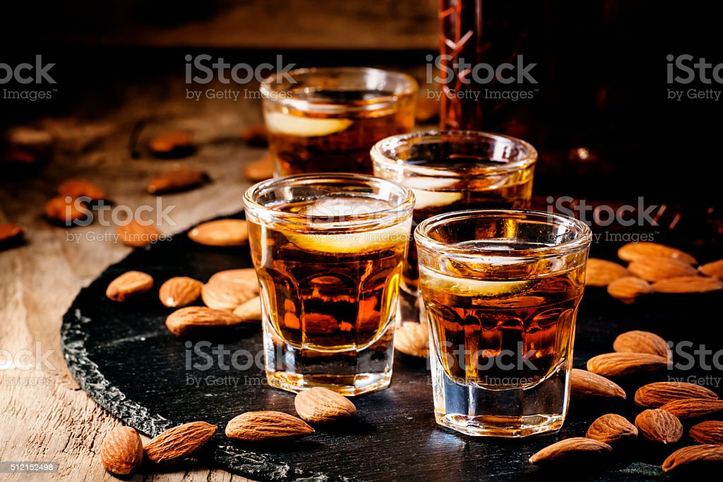 Brandy and almonds, small glasses stock photo