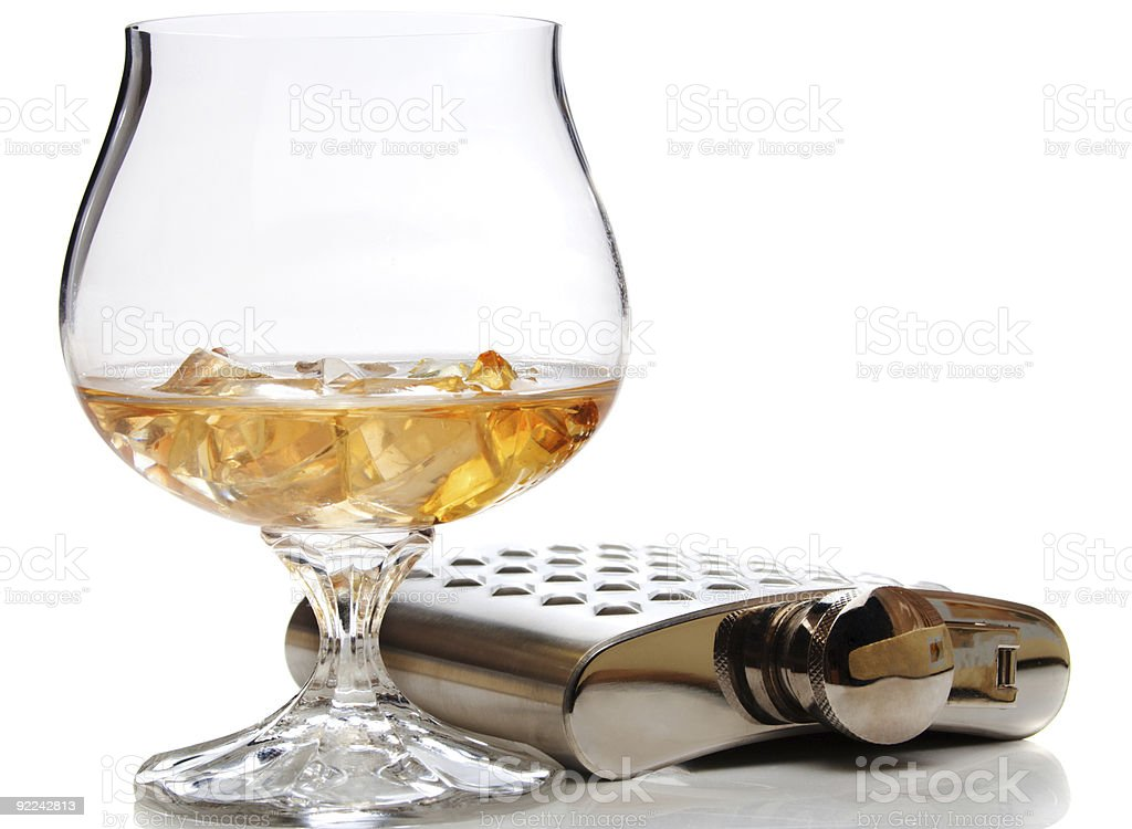 Brandy glass and hip flask royalty-free stock photo