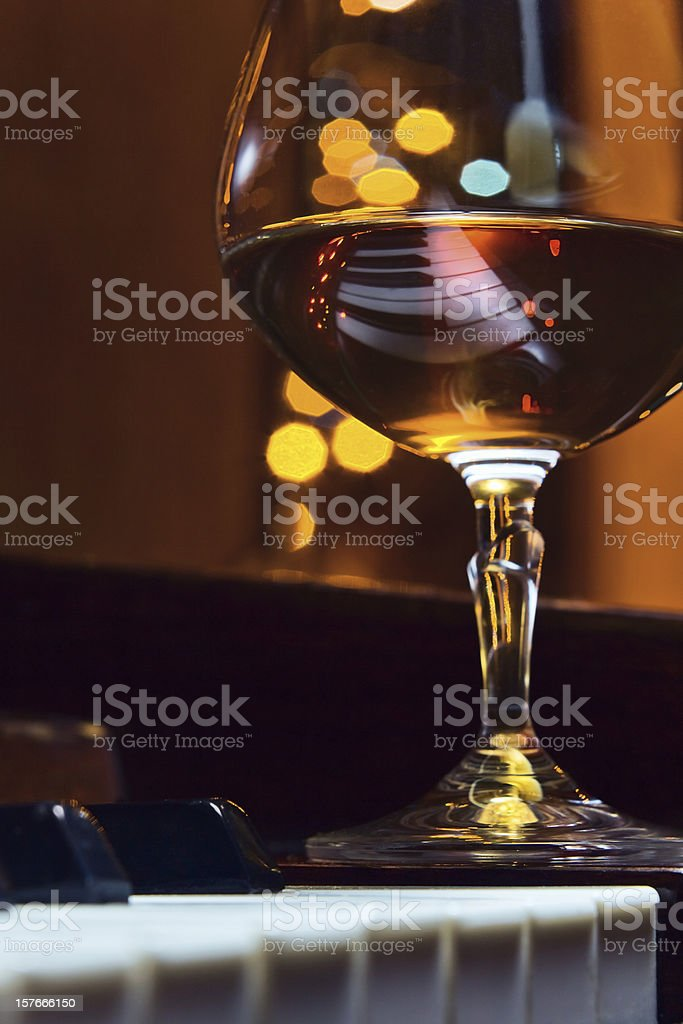 brandy on a piano royalty-free stock photo