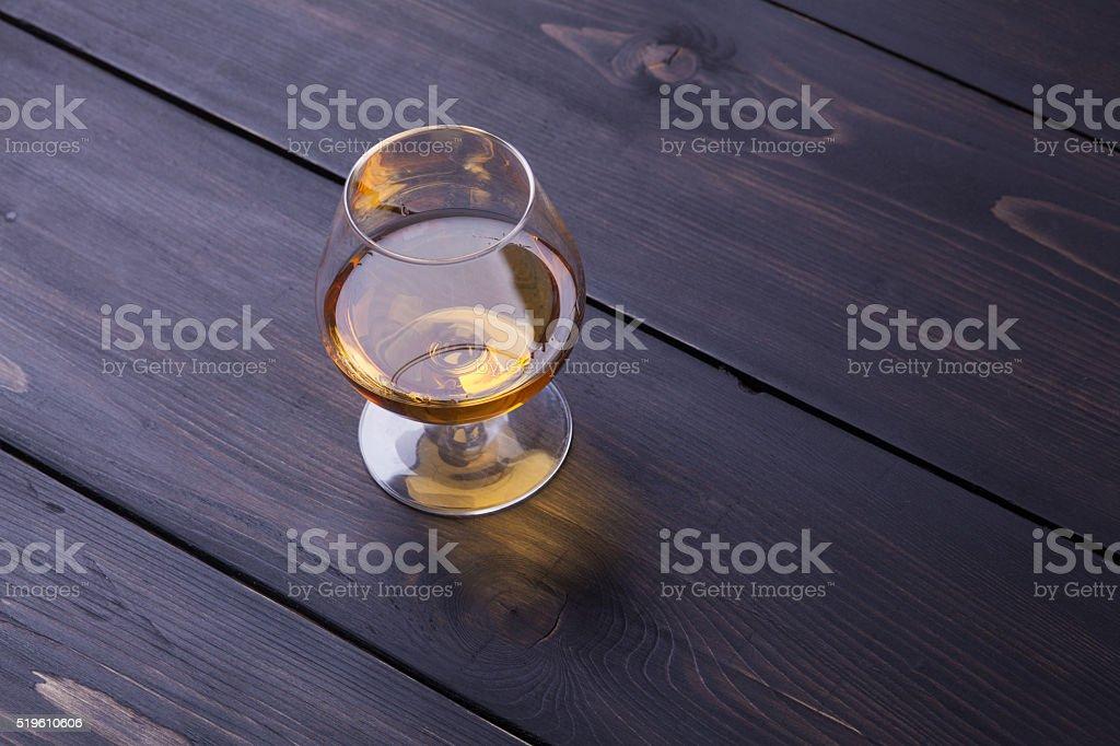 Brandy on dark wood stock photo