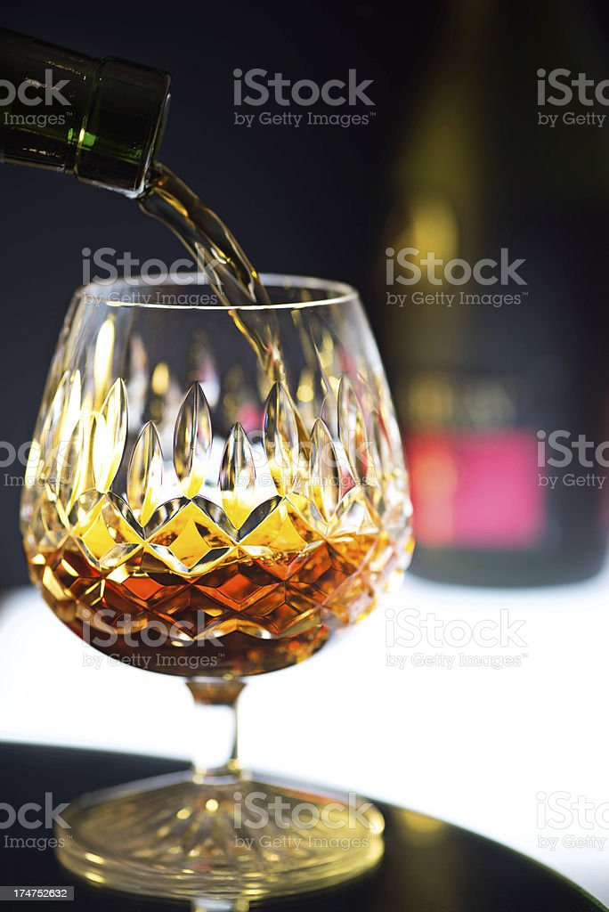 Brandy pours into Crystal Glass stock photo