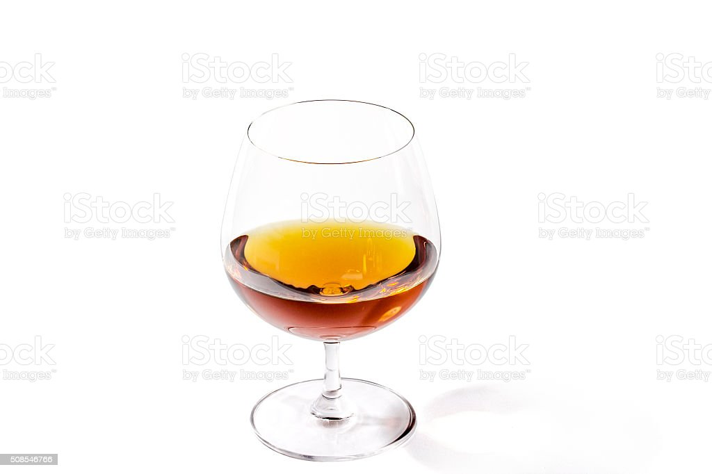 Brandy shimmers with rich colors in a goblet stock photo