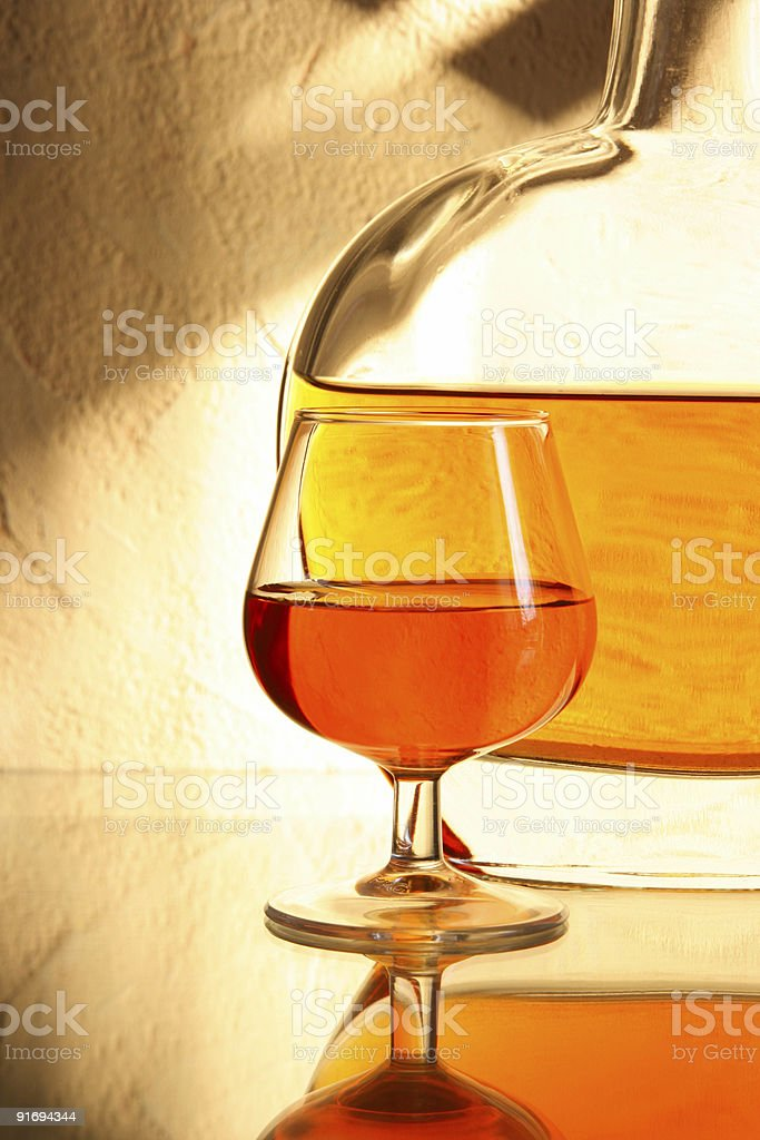 Brandy snifter glass and bottle royalty-free stock photo