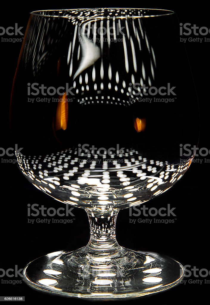 Brandy snifter with reflections stock photo