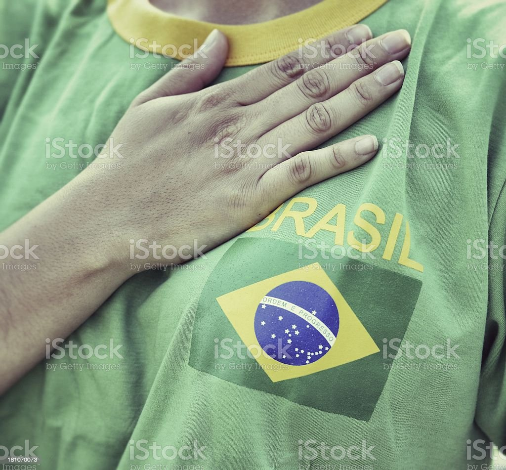 Brasilian Fan Putting Hand on Hearth During the National Anthem stock photo