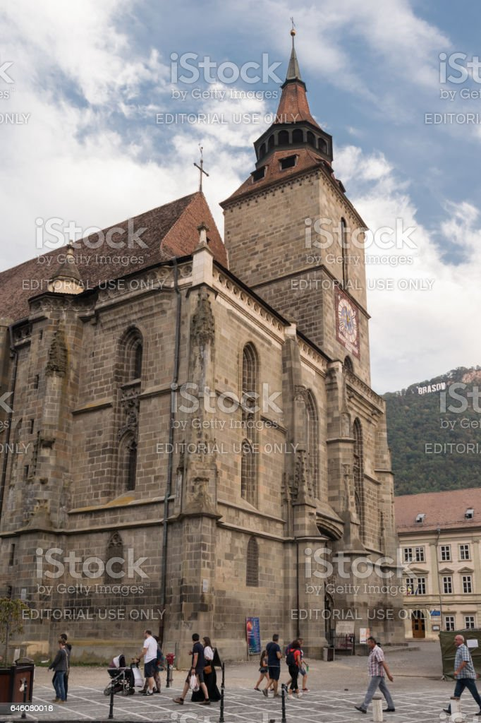 Brasov,Transylvania,Romania - September 22 2016 : Tourist walk along side the famous gothic style monument known as 'Black Church' circa 2016 stock photo