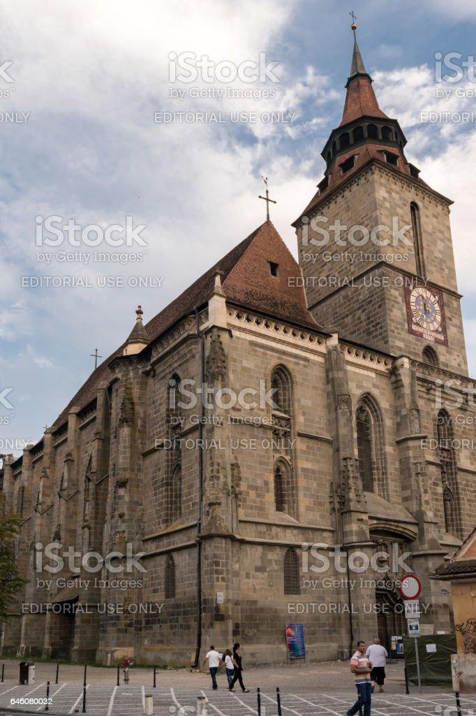 Brasov,Transylvania,Romania - September 22 2016 : Tourist walk along side the famous gothic style monument known as 'Black Church' circa 2016 stock photo