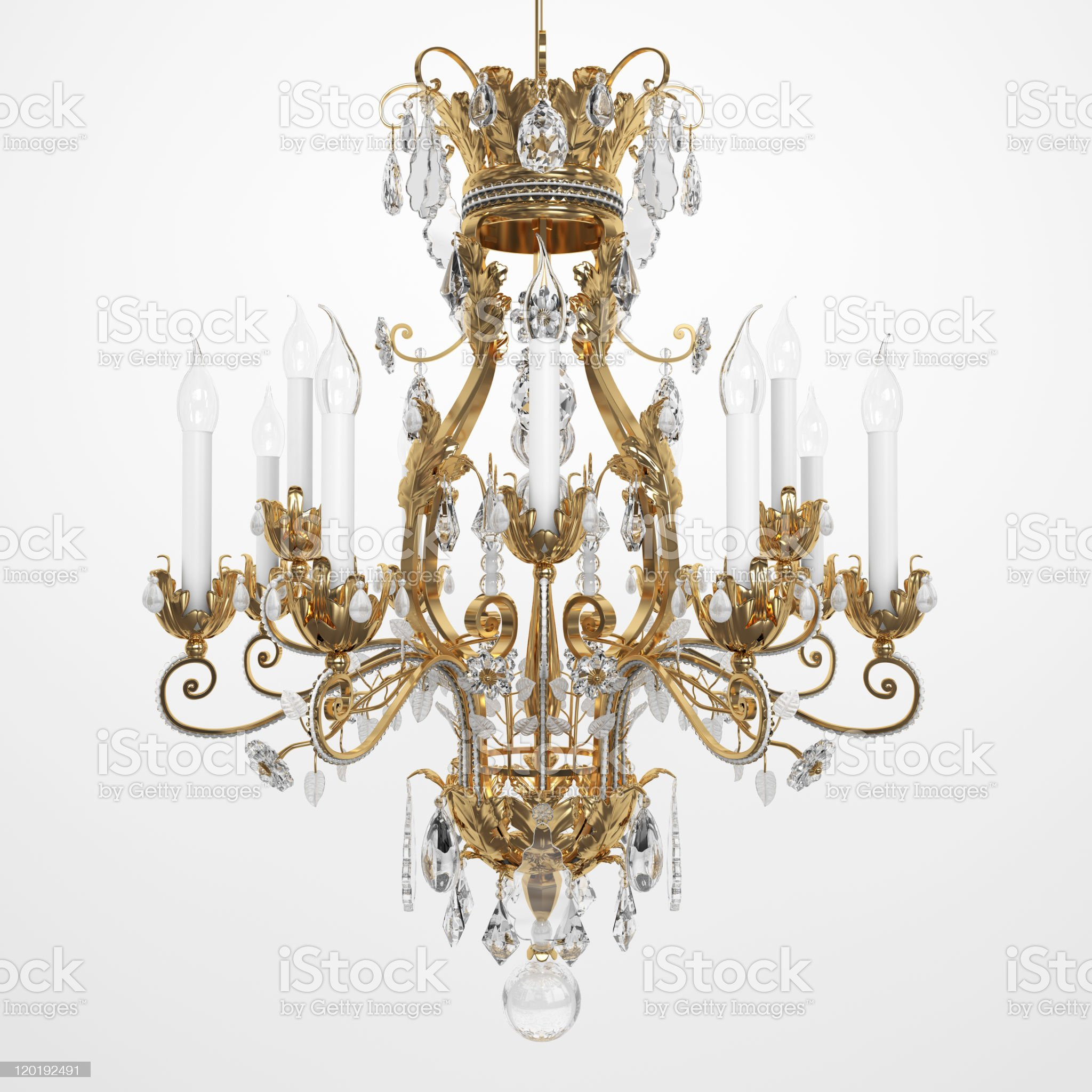 Brass and glass chandelier with white candles royalty-free stock photo