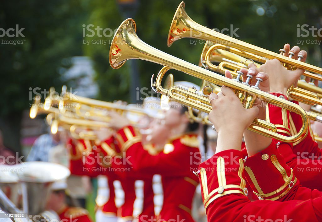 Brass band of girls playing their instruments together stock photo