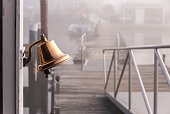 Brass Bell at Ferry Dock - Foggy Morning