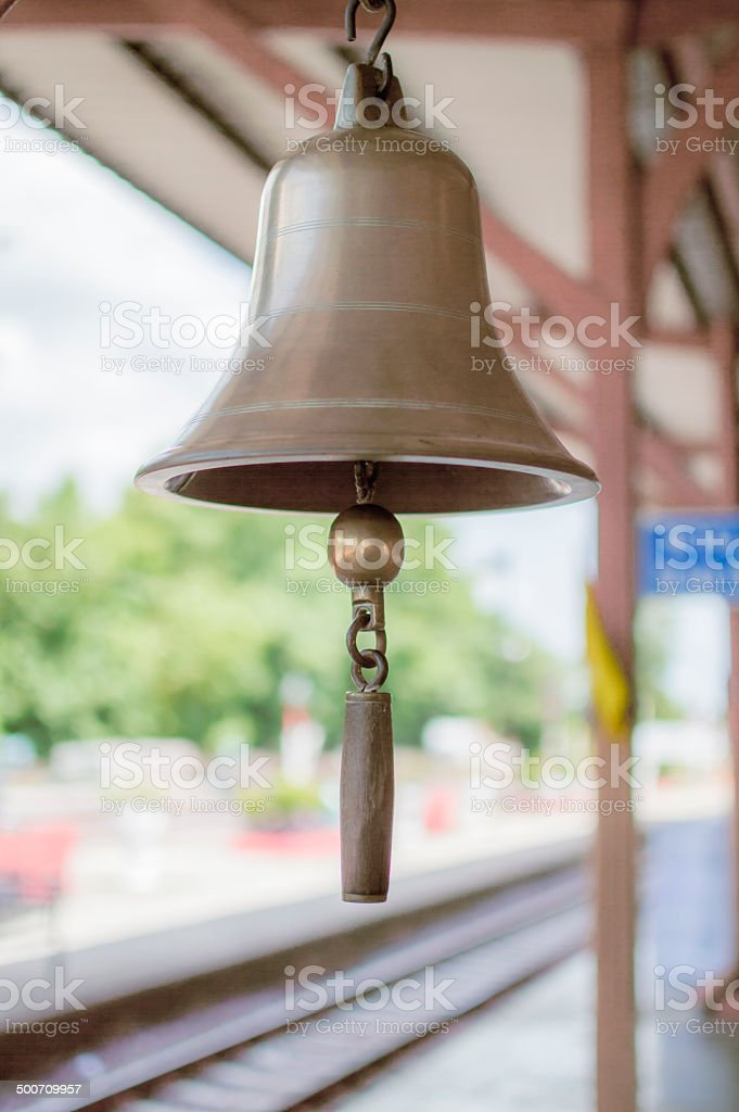 Brass bell in train station stock photo