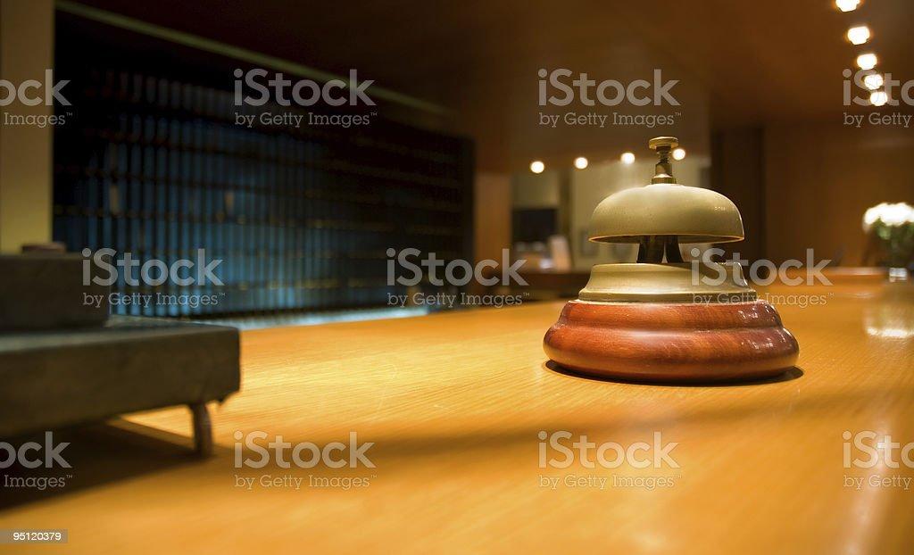 Brass bell on hotel reception (shallow dof) stock photo