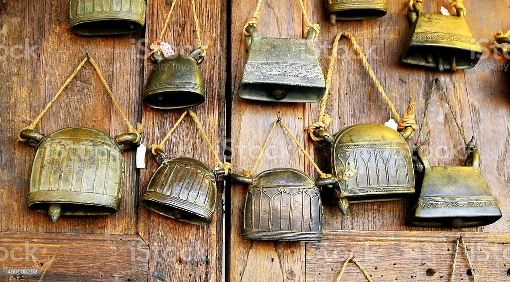 brass bell on wood wall royalty-free stock photo