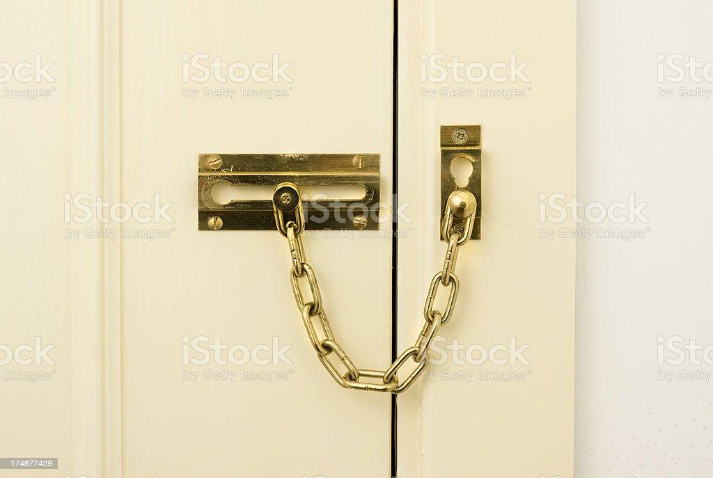 Brass chain door lock stock photo