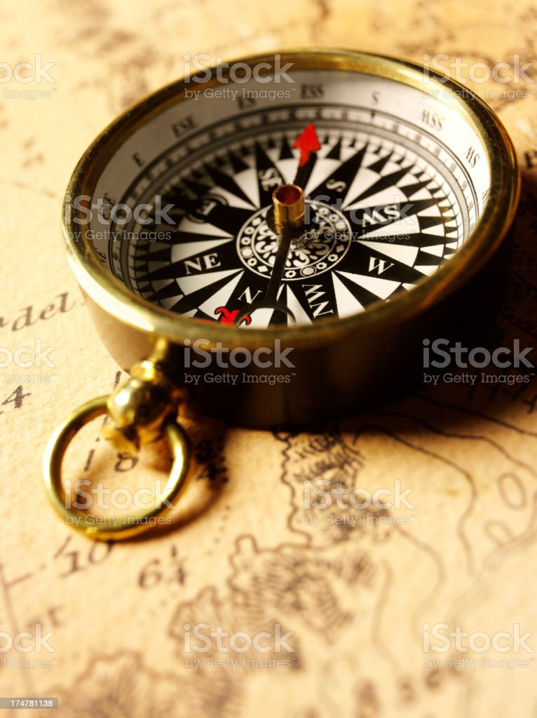 Brass Compass on a Nautical Chart stock photo