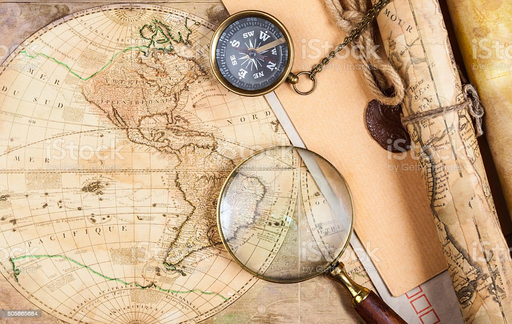 Brass compass on a old map background stock photo