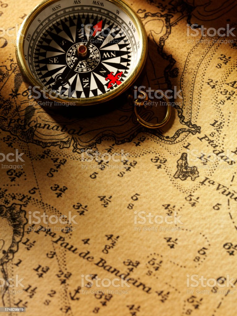 Brass Compass on a Old Nautical Chart royalty-free stock photo