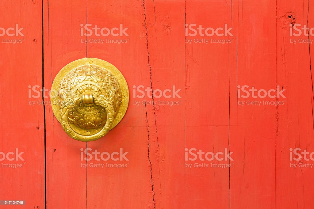 Brass door handle and knocker stock photo