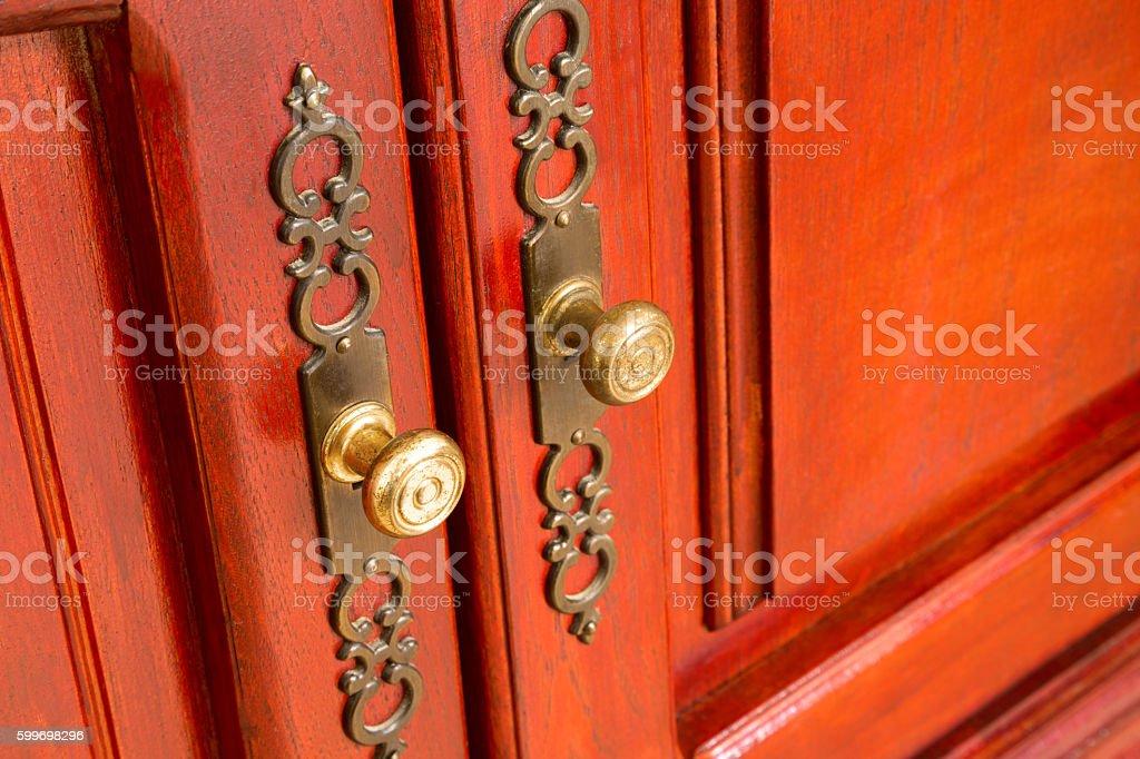 Brass door handles with ornate escutcheons stock photo