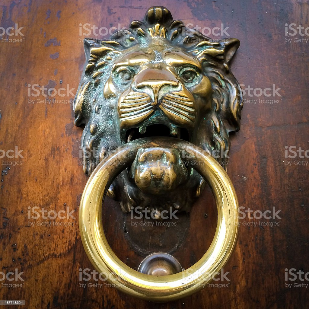 Brass door knocker on wooden door stock photo