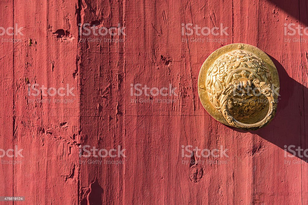 Brass drawer handle on the red wooden door stock photo