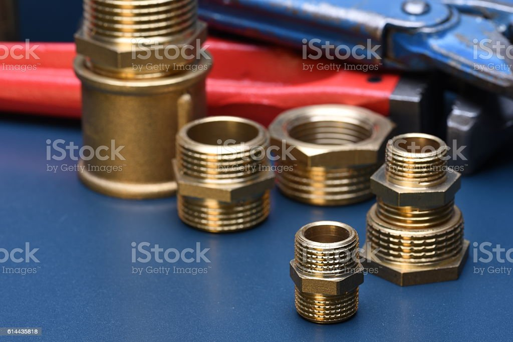 Brass fittings and wrench stock photo
