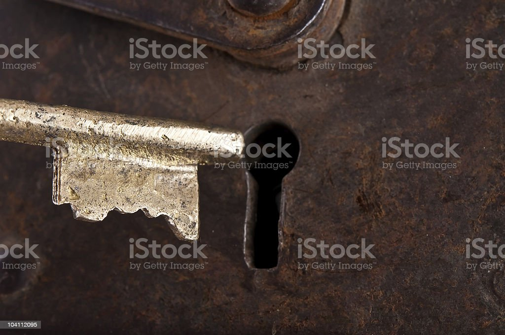 Brass Key going into Keyhole stock photo